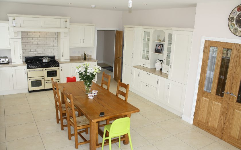 brown kitchen design with dining table