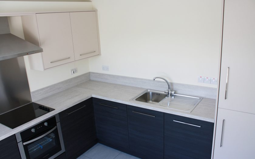 contract kitchen design, cupboards, sink and cooker